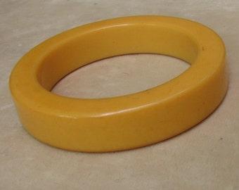 A Chunky Yellow Bakelite Bangle Bracelet