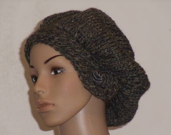 Knitted thick cap with volume from a Moulinegarn in camouflage colors