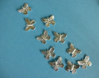 Butterfly silver charm.     Bright silver plate.   19mml  x 15mm  Set of 15.  Lead and nickle free.