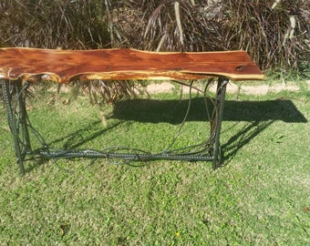 Live edge red cedar and iron rebar table. Handcrafted in Texas.