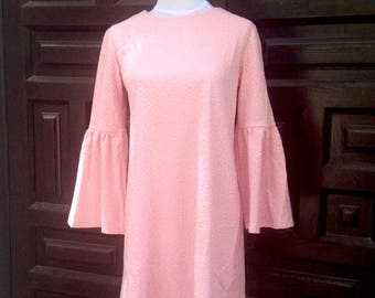 Pink dress with flared sleeve