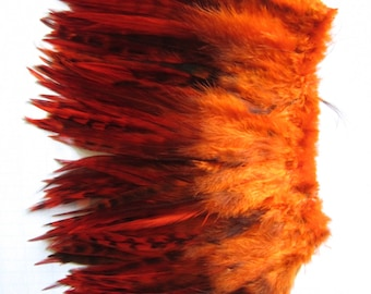 """4+"""" strip of Strung Rooster Saddles Chinchilla feathers in ORANGE with black - individual feather about 5-5.5"""""""