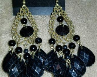 Black tear drops with vintage gold color.