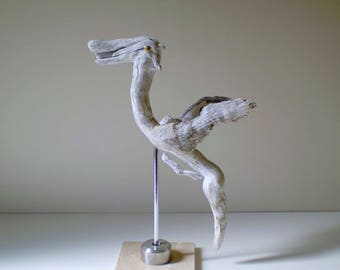 Animal Driftwood carved, presented on a marble base - unique Creation