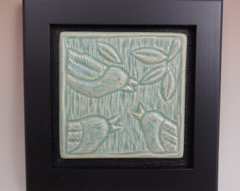 Carved bird tile