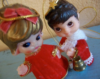two big eyed plastic angel ornaments