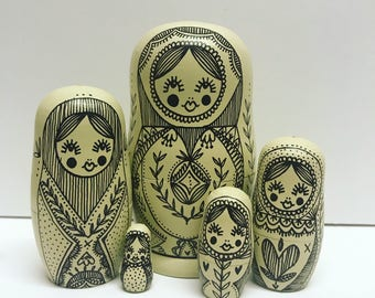 Pale yellow matryoshka dolls, russian nesting dolls, quirky home decor