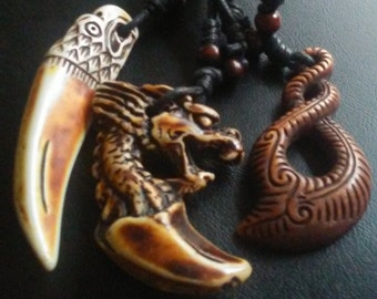 One eagle biker tooth,dragon tooth, and spiral maorii fish hook, free shipping