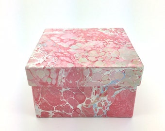 Rose colored hand marbled paper box with deep blue lining