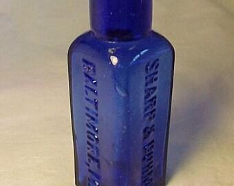 c1890s Sharp & Dohme Baltimore, MD., Cork Top Cobalt Blue Glass Triangle round back Poison Bottle