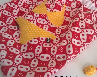 Red and yellow fabric underwear bag.