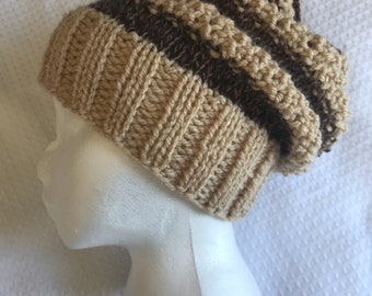 Mixed fiber patchwork rust brown tan with a touch of red and dark teal hand knit slouchy beanie hat