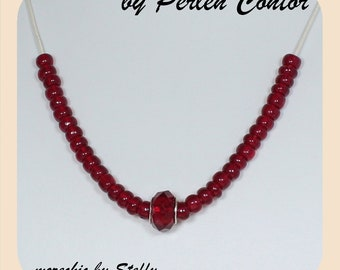 Necklace, handmade, ruby-red, faceted bead, jewelry beads on cotton ribbon (AZ1253)