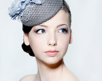Grey felt beret with silk dupion and silk organza open rose and veiling perfect for weddings or the races.
