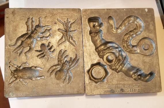 2 vintage metal molds bugs insects and robot parts 1993 and 1964 vintage toys moulds