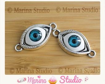 Eye connector set in resin backed with silver colored metal kabbal, evil eye protection