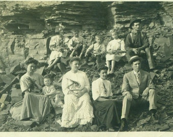 Antique Family Sitting On Cliff Rocks Portrait RPPC Real Photo Postcard Vintage Black White Photo Photograph