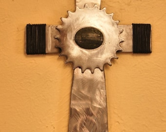 Vintage gear and leather cross
