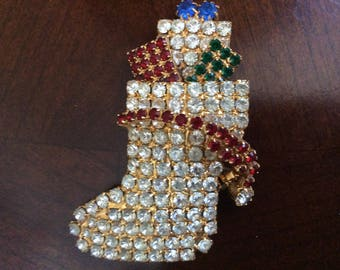 A Pretty! Christmas Stocking Figure Brooch with colored Rhinestones.