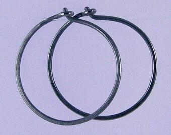 Small KISS hoops: Black niobium hoop earrings