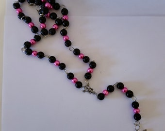 Black and hot pink rosary bead