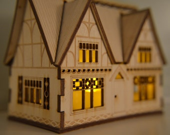 Intricate laser cut thatched cottage nightlight