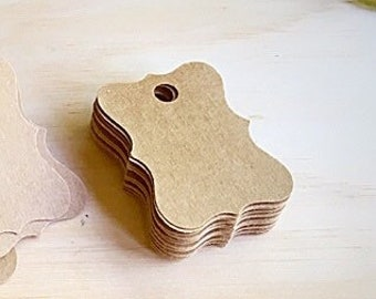 "200 ~ kraft gift tags. Brown kraft card-stock tags . Tag measures 1-1/2 x 1 "" wide. Handmade tags for sale items."