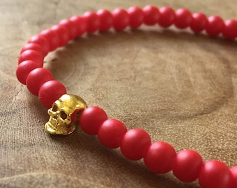 Red Gold Skull: an elastic beaded bracelet with gold skull and matte red glass beads.