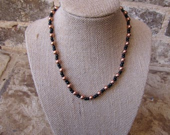 Rose gold and black choker with a clasp