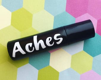 ACHES: awake and aches. 100% Pure Therapeutic Grade Essential Oil Roller Ball Blend.