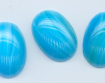 Two rare vintage Japanese Cherry Brand glass cabochons - swirled aqua with hints of green - 25 x 18 mm