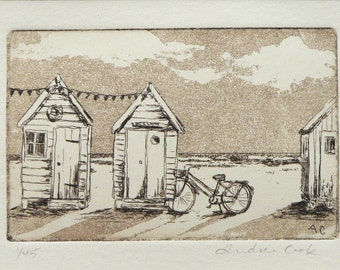 original etching and aquatint of beach huts and a bicycle
