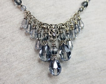 Rainy day, A necklace with grey/blue luster beads and crystal teardrops.
