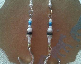 Spur dangle earrings