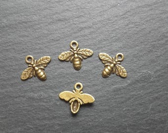 4 antique bronze bee charms