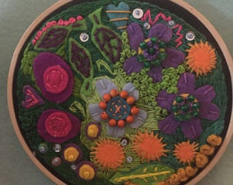 Hand sewn embroidery , original design , one of a kind , ready to hang in wooden hoop , floral design, flowers, hearts and leaves,