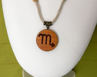 Wooden pendant laser engraved with the signs of the zodiac. (Scorpio)