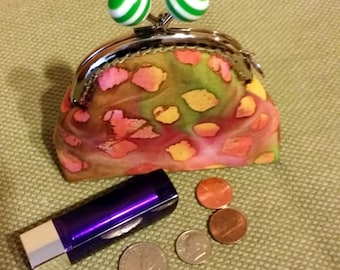 Coin purse with spunky metal kiss lock push frame and over sized  striped pink balls, charm, yellow, pink green blob print cotton