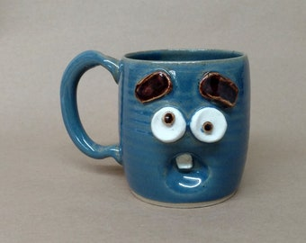 Nelson Studio Stoneware Pottery Cup. Worried Monday Morning Mug. Blue Stoneware Pottery Ceramic Mugs. Funny Overwhelmed Worried Face Mug.
