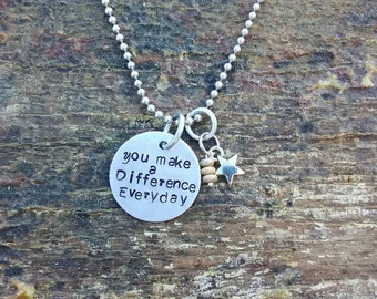 You make a Difference Everyday hand stamped pendant. Your choice of either Necklace or Keychain