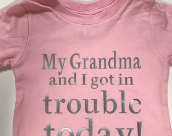 Size 12 - 18 Month, Light Pink tee with Silver lettering (lighter than the pic).  My grandma and I got in trouble today