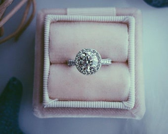 Halo set round cut tapering pave shank diamond engagement ring