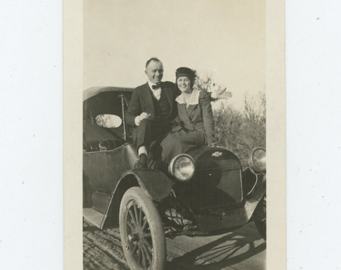 Vintage Snapshot Photo: Couple on Hood of Chevrolet, c1910s (87699)