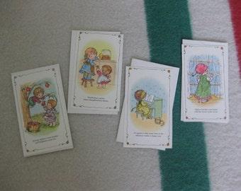 A Set of Four Hallmark Postcards With Little Children