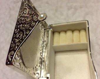 Silver filigree mirrored top jewelry trinket box.