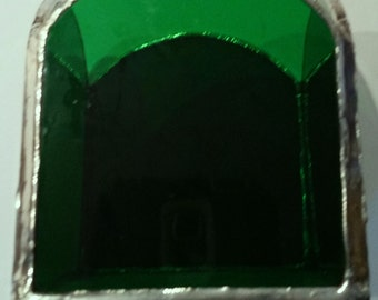 Green stained glass tea light candle holder.