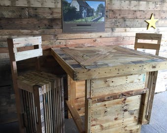 Bar table with bar stools handmade from 100% reclaimed pallet wood.
