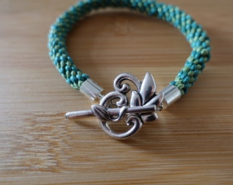 Two-tone green kumihimo bracelet