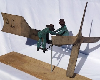 A folky whirligig with two African-American figures turning a crank. Great Folk Art piece. (Offers Considered)