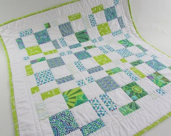 Quilted Square Table Topper - fresh white paired with cool blue, turquoise and green makes this a bright addition to your home